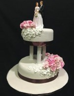 Floral Wedding Cake with pillars